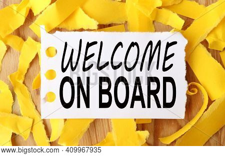 Welcome On Aboard .text On White Paper Over Torn Paper Background.