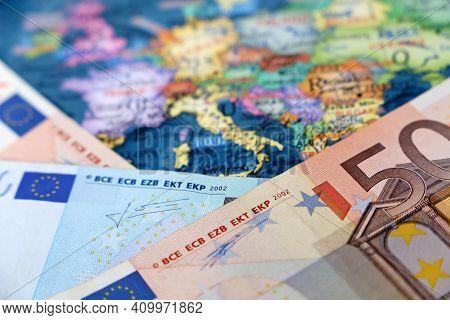 Euro Banknotes On The Europe Map. Concept Of Eurozone, European Economy, Stock Market In Eu