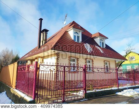 Moscow, Russia - 24 November 2020: Traditional Country House In Russia. Rustic House With Stucco Wal