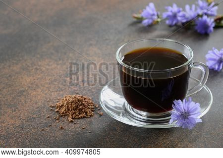 Healthy Chicory Drink In Glass Cup Decorated Chicory Flowers.herbal Beverage, Coffee Substitute. Clo