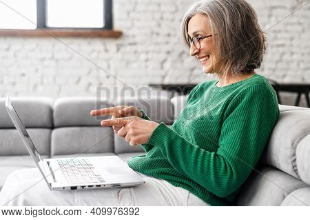 Side View Of An Elderly Woman Full Of Life, Thin Beautiful Grey Hair, Saw Shocking And Pleasant In A