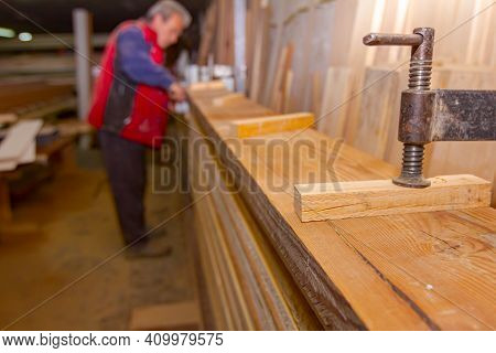 Process Of Drying Glue In The Manual Production Of Wooden Profiles In Carpentry. Clamp Tool For Fixi
