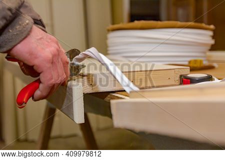 Carpentry Worker Is Holding Red Metal Pliers And Cutting Rubber Tape That Is Putted In Wooden Door F