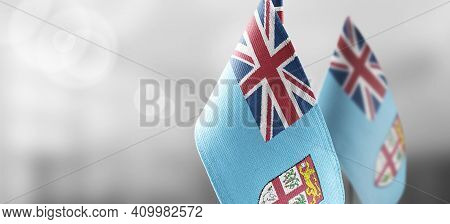 Small National Flags Of The Fiji On A Light Blurry Background