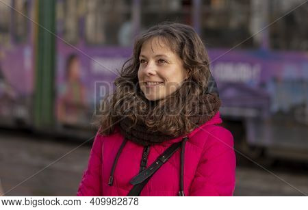 A Street Portrait Of A Cheerful, Successful Middle-aged Woman With Delicate Features. A Woman Of 30-