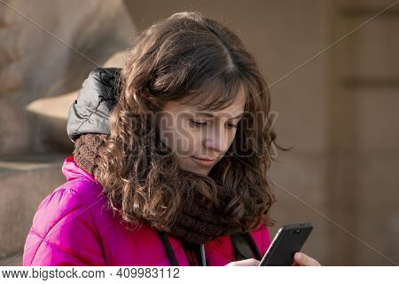 Street Portrait Of A Cheerful, Successful, Middle-aged Young Woman With Delicate Features, Looking A