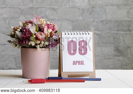 April 08. 08-th Day Of The Month, Calendar Date.a Delicate Bouquet Of Flowers In A Pink Vase, Two Pe