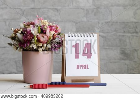 April 14. 14-th Day Of The Month, Calendar Date.a Delicate Bouquet Of Flowers In A Pink Vase, Two Pe