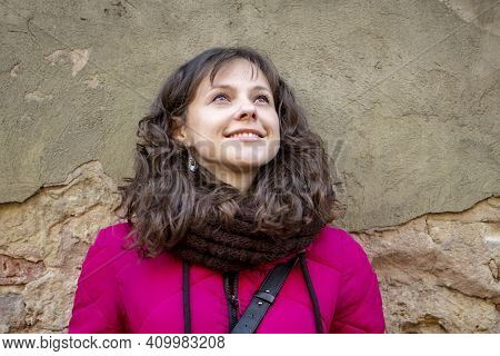 A Street Portrait Of A Cheerful, Successful Middle-aged Woman With Curly Hair And Delicate Features
