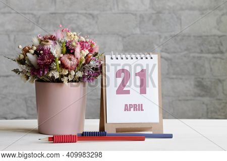 April 21. 21-th Day Of The Month, Calendar Date.a Delicate Bouquet Of Flowers In A Pink Vase, Two Pe