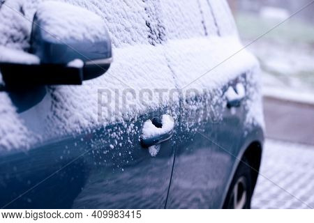 A Portrait Of The Side Doors And The Wing Mirror Of A Car Getting Completely Snowed Under During A S