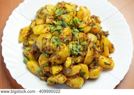 Indian Nepali Style Aloo Or Alu Fry Recipe Served On A Plate. Potato Fry, Boiled And Fried Potato Re