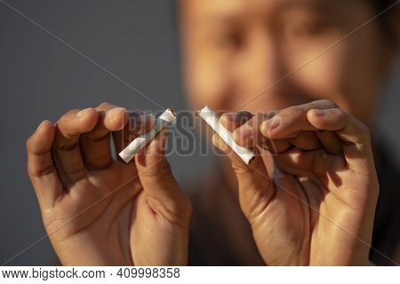 Beauty Woman Happy To Breaking A Cigarette. Wold Tobacco Day And  Quit Smoking Cigarettes Concept