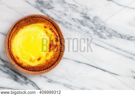 Egg Tart, Traditional Portuguese Dessert, Pastel De Nata In A Gray Plate On A Marble Background . Po