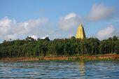 Gold buddha Gaya near a river in Sangklaburi Thailand poster