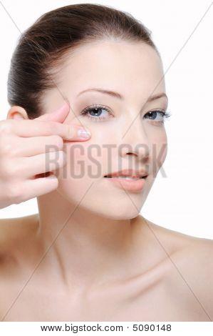 Squeeze Skin Near Eye