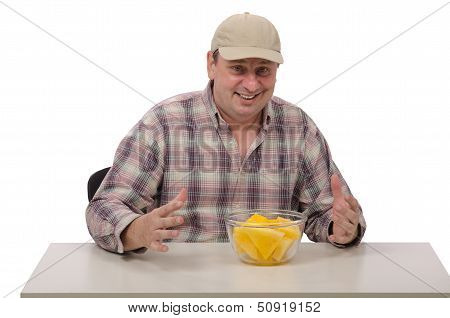 Man In A Baseball Cap Will Test The Yellow Watermelon
