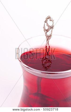 a glass of black tea
