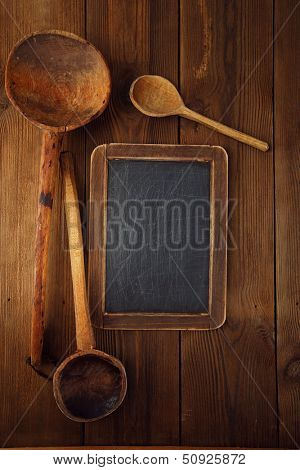 retro kitchen utensils  wood spoon on old wooden table in rustic style
