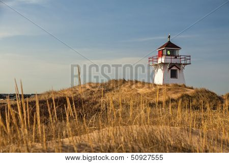 Lighthouse nestled in the sand dunes at Dalvay, in Cavendish National Park, on the north shore of Prince Edward Island, Canada.