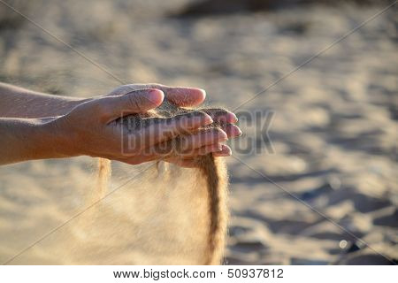 sand pours out of the hands