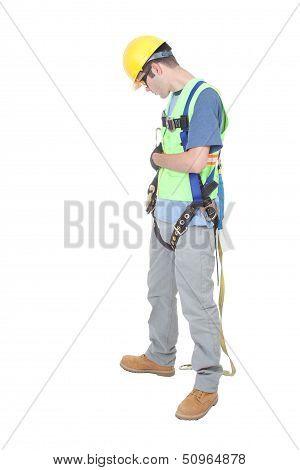 Man Checks Fastenings On Climbing Harness