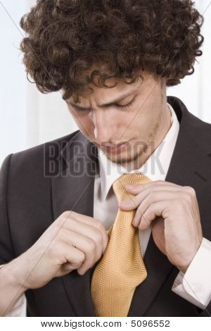 Business Man fixes His Scarf
