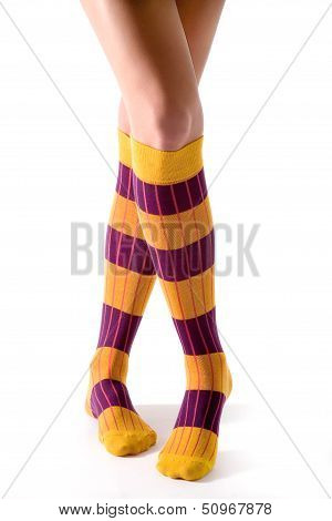 Young Woman Crossed Legs Posing With Yellow Striped Socks
