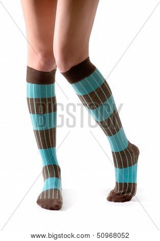 Young Woman Legs Posing With Turquoise Striped Socks