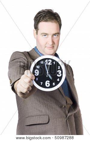 Businessman Showing Clock