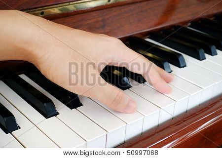A hand on a piano