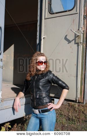 Young Girl Poses Near The Iron Trailer