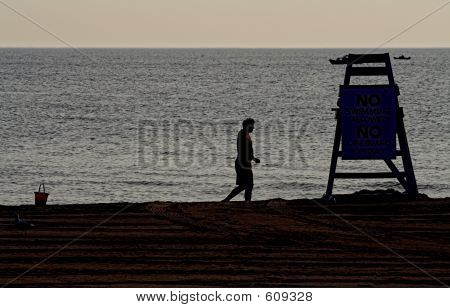 Lonely Man And Lifeguard Tower