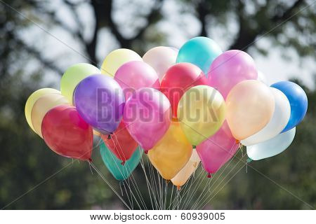 multicolored balloons and confetti in the city festival