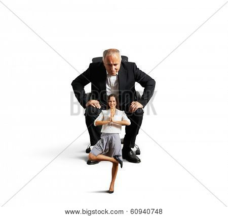 senior man sitting on the office chair and scrutinizing meditation smiley woman