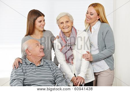 Home nursing for senior citizen couple with caregiver at home