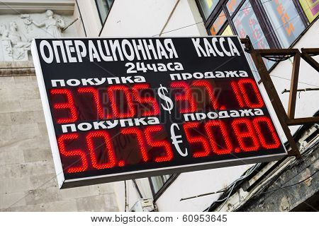 MOSCOW, RUSSIA - MARCH 04, 2014: Electronic board - daily exchange rate. Prices for cash currency in Russia once again set record. 1 U.S. dollar is now worth 37,1 ruble, and 1 euro - 50,8 ruble