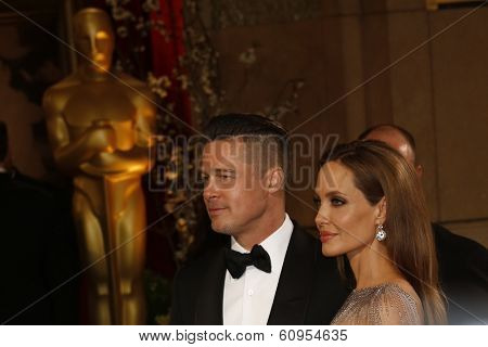 LOS ANGELES - MAR 2:: Brad Pitt, Angelina Jolie  at the 86th Annual Academy Awards at Hollywood & Highland Center on March 2, 2014 in Los Angeles, California
