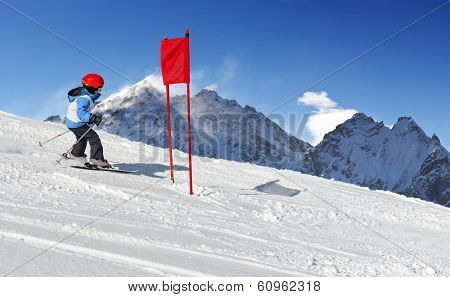 Young child during his ski school slalom run