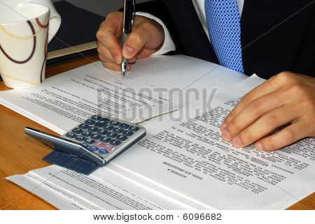 Reviewing and signing a business contract or a lease