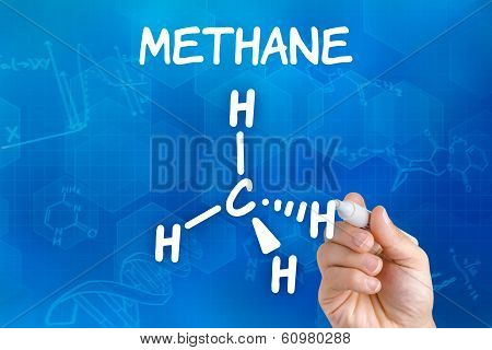 Hand with pen drawing the chemical formula of methane