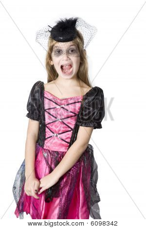 little cute girl in carnival fancy dress on the eve of Halloween