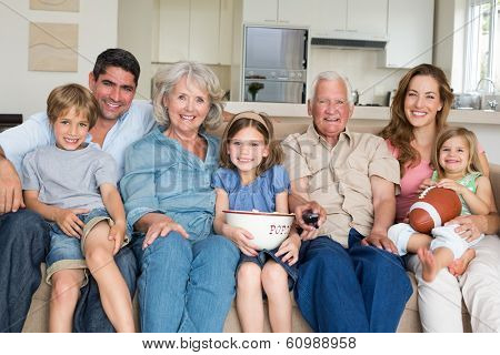 Portrait of smiling multigeneration family spending leisure time together at home