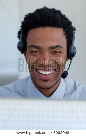 Portrait Of A Smiling Afro-american Businessman In A Call Center