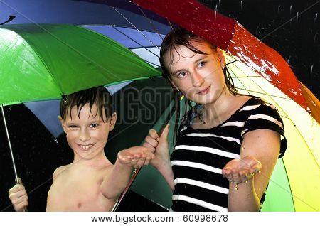 happy kids walking under the rain