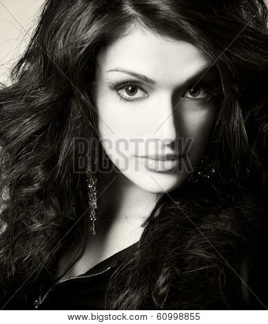 close up portrait of young beautiful brunette, studio shot