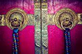 Vintage retro hipster style travel image of door handles on gates of Ki monastry. Spiti Valley, Himachal Pradesh, India poster
