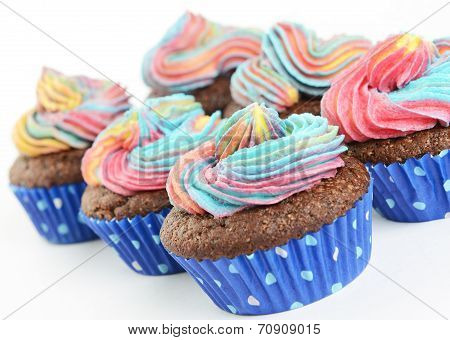 Chocolate cupcakes with colour icing