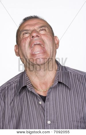 Portrait Of Mid Adult Male Screaming. Isolated.