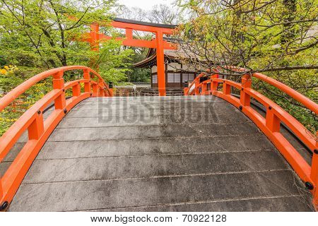 Japanese architecture, Orange arched bridge and Torii in shimogamo-jinja, Kyoto, Japan poster